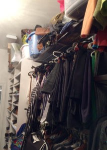 Left side of closet before The Spruce Goose. Purses are in laundry baskets, smushed and unseen. There are too many clothes that are hard to find.