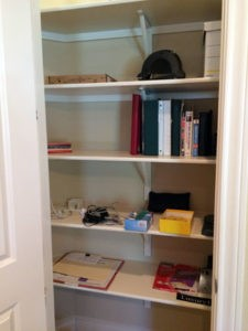 "An office closet needing some ""sprucing""."