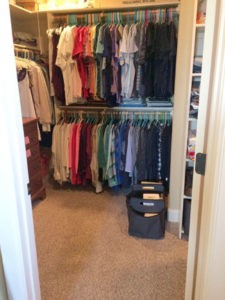 The Spruce Goose organizer finds places for all of the items that were in this closet, plus sorts clothes by type and color.